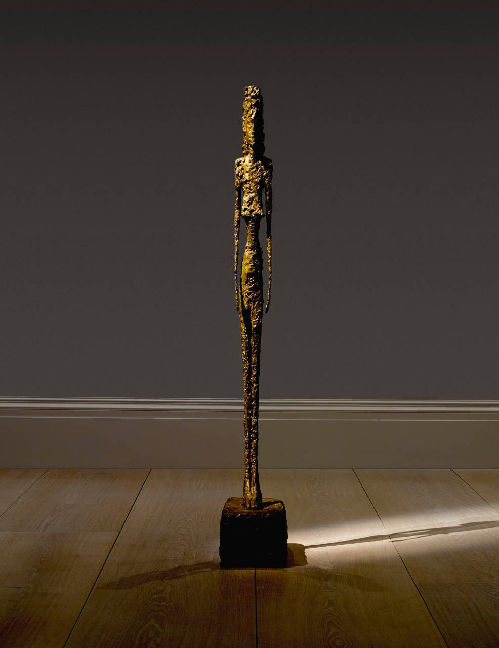 Alberto Giacometti, GRANDE FIGURE. Inscribed A. Giacometti, dated 1947 and with the foundry mark Alexis Rudier Fondeur, Paris. Bronze, height: 130.3cm. 51 1/4 in. Executed in plaster in 1947, this unique bronze was cast by the Alexis Rudier foundry in Paris in 1948.