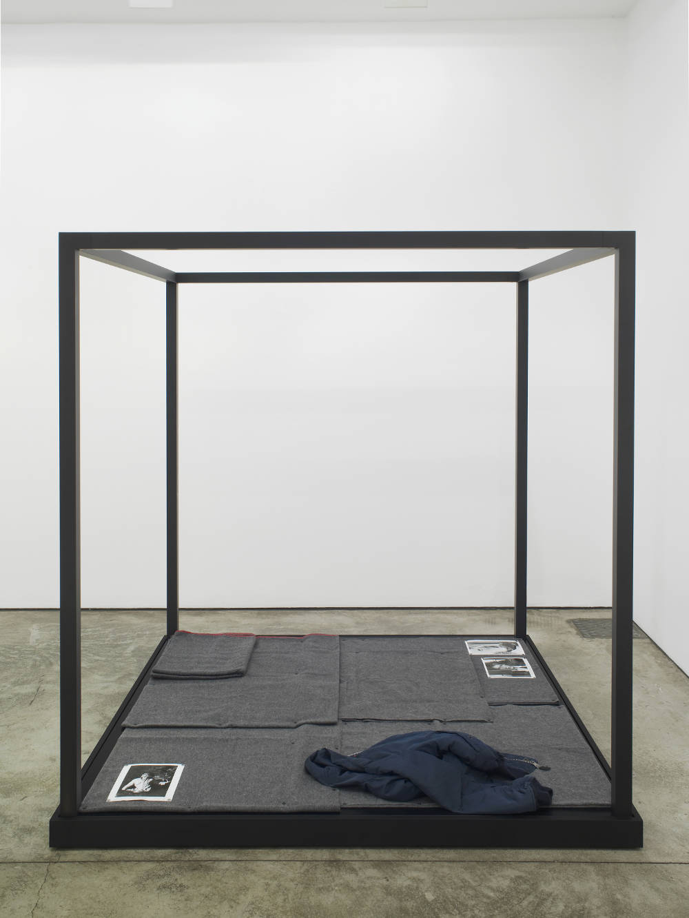 Tom Burr, Regarding the Recent Attack on the Body (my aging blue bomber), 2017. Grey military style blankets, black upholstery tacks, silver gelatin  lm still prints from 'Equus' (1977), steel push pins, powder coated aluminium, painted plywood 184 x 180 x 180 cm