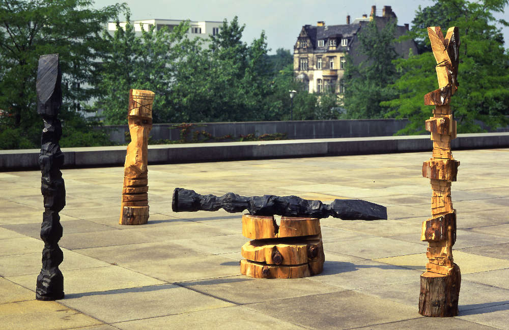 """A.R. Penck, """"Memorial to an Unknown East German Soldier"""", 1984. Wood, bronze, plastic in eight parts. Dimensions variable"""