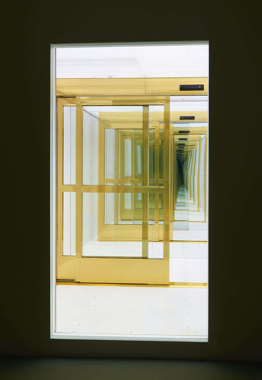 Sean Shim-Boyle, Fee Fi Fo Fum, 2018. Gold-wrapped motion-activated doors and two-way mirror