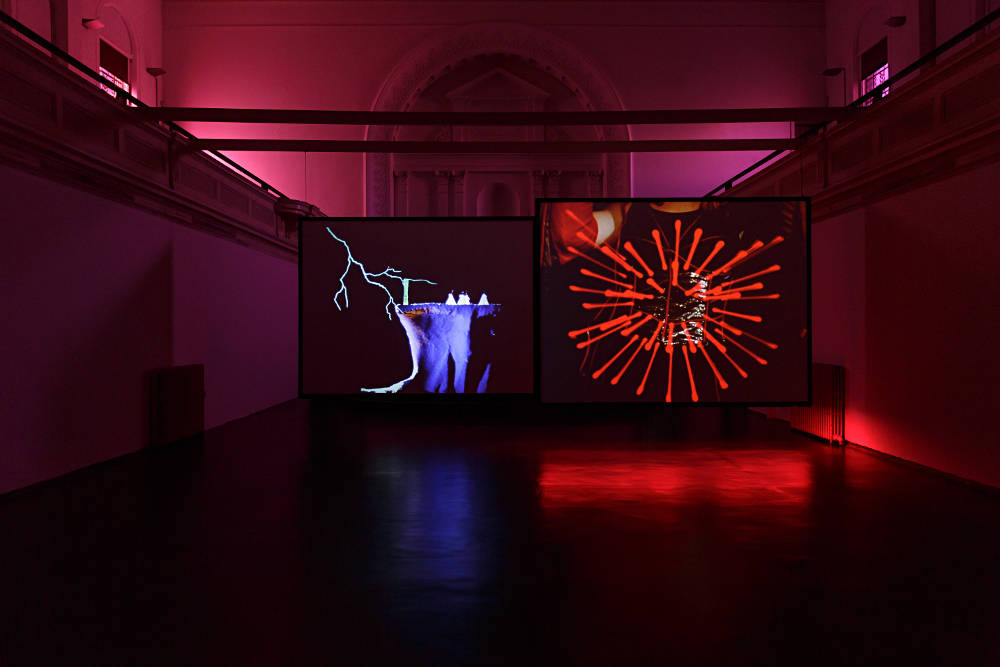 Ericka Beckman, Hiatus, 1999/2015. Dual screen installation, 16mm transferred to HD video, colour, sound, synchronised LED track, 20'15 mins. Installation view, Zabludowicz Collection, London, 2018. © The artist, courtesy Zabludowicz Collection. Photo: Tim Bowditch