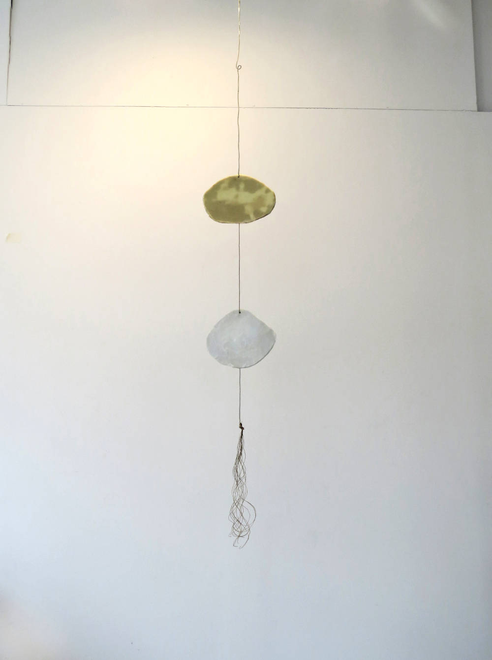 Lisbeth McCoy, Bumppo III, 2018, plaster on burlap, wax, paper, wire, string
