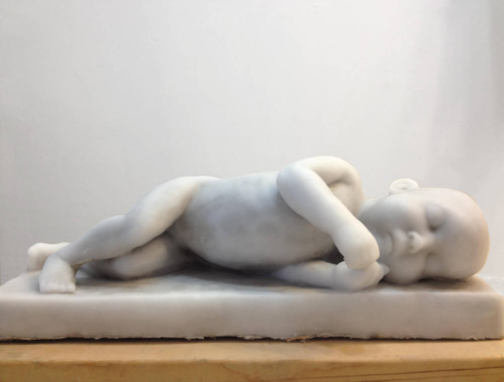 Lisbeth McCoy, Sleeping Infant, 2010, wax and Ultracal, 21(L) x 7(W) x 7.5(H) inches