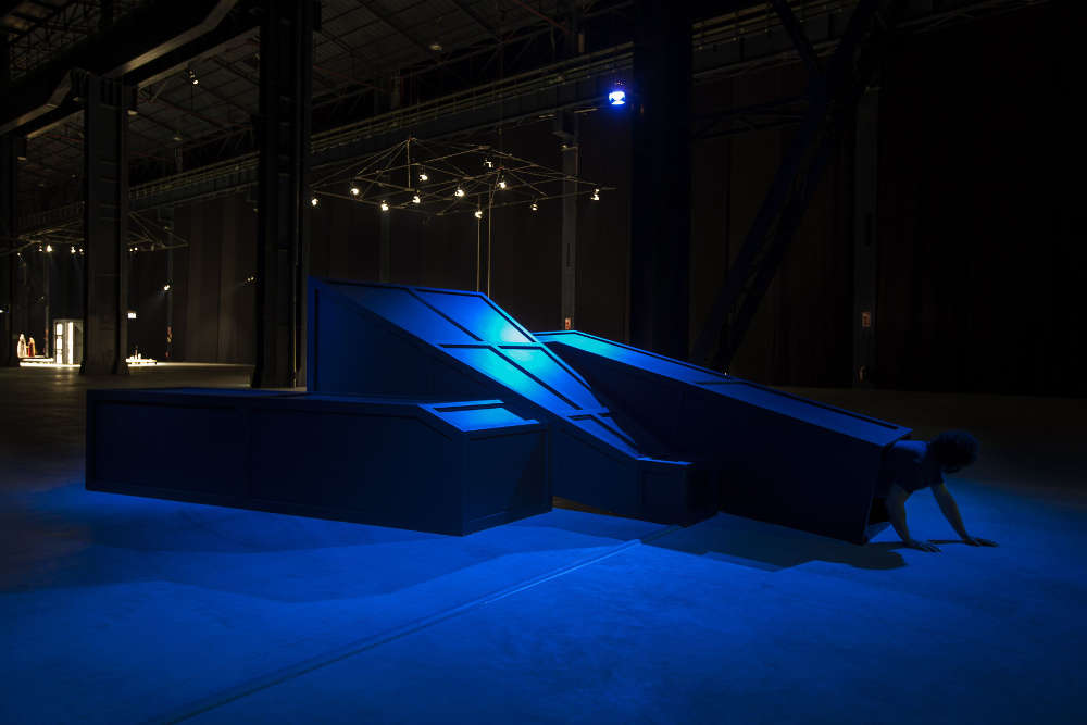 Mike Kelley, Rose Hobart II, 2006. Installation view, 'Mike Kelley. Eternity is a Long Time' Pirelli HangarBicocca, 2013. Wood, metal, carpet, acrylic paint, with video projection and sound 182.9 x 452.1 x 609.6 cm / 72 x 178 x 240 in © Mike Kelley Foundation for the Arts. All Rights Reserved/VAGA at ARS, NY, Courtesy the Foundation and Hauser & Wirth.