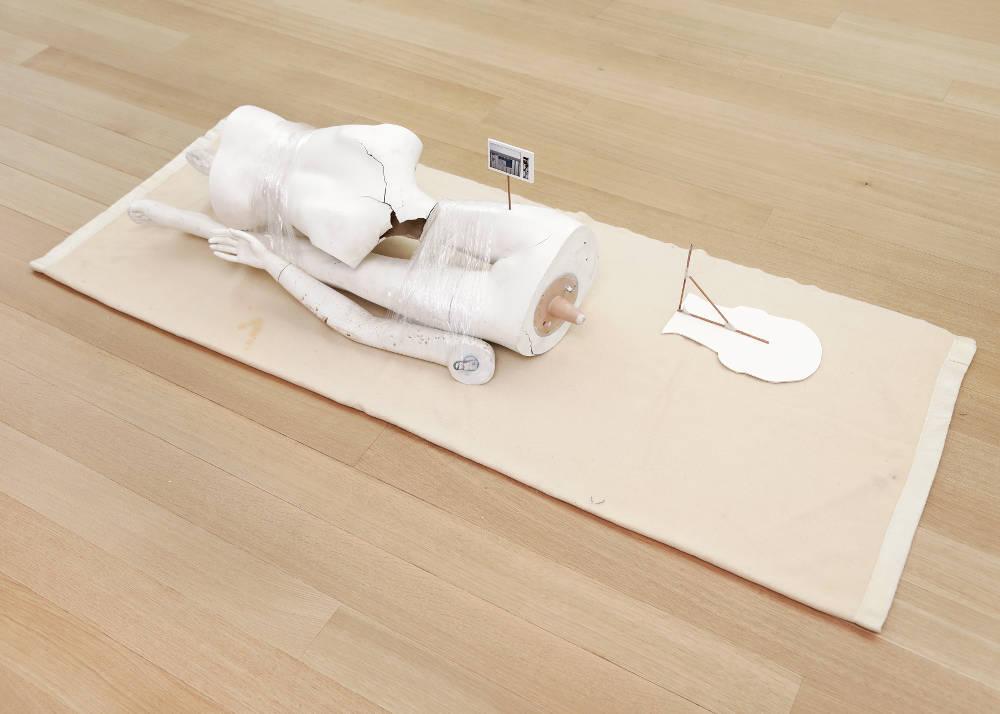 Win McCarthy, Real Words, 2017. Blanket, mannequin parts, foam, shrink wrap, wood, foamcore, c-print, tape, glue 40.6 x 45.7 x 78.7 cm (16 x 18 x 31 in.)