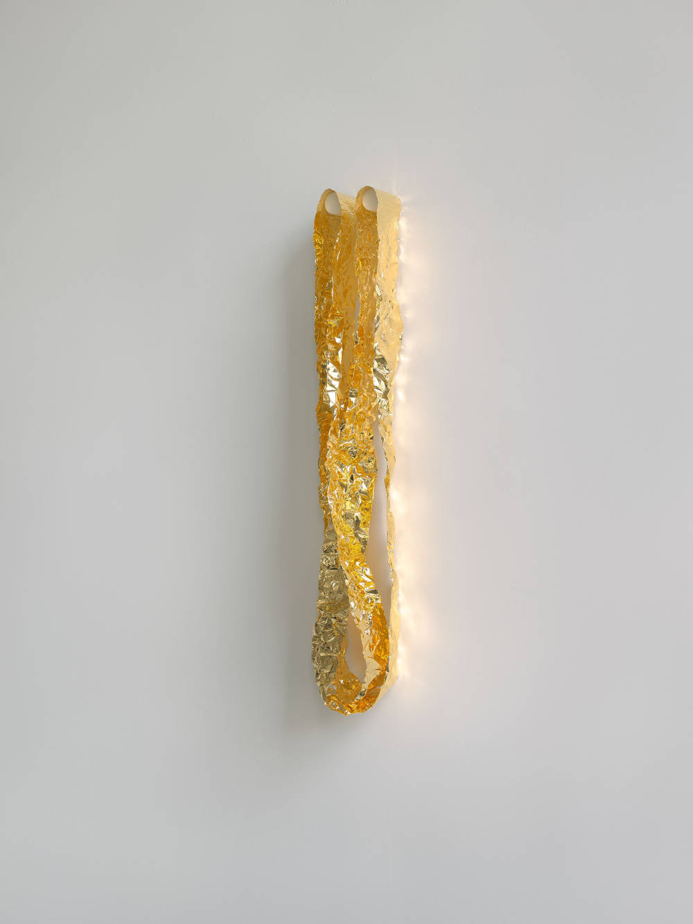 "Roni Horn, Double Mobius, v. 2, 2009/2018. Gold foil: ""4 Nine"" pure (with 2 plastic pegs) Ed. 1/3. Ribbons: 6.4 x 152.4 x 0.002 cm / 2.5 x 60 x 0.0008 in each, 2 parts. Installed: 6.4 x 76.2 x 5 cm / 2.5 x 30 x 2 in (overall)"