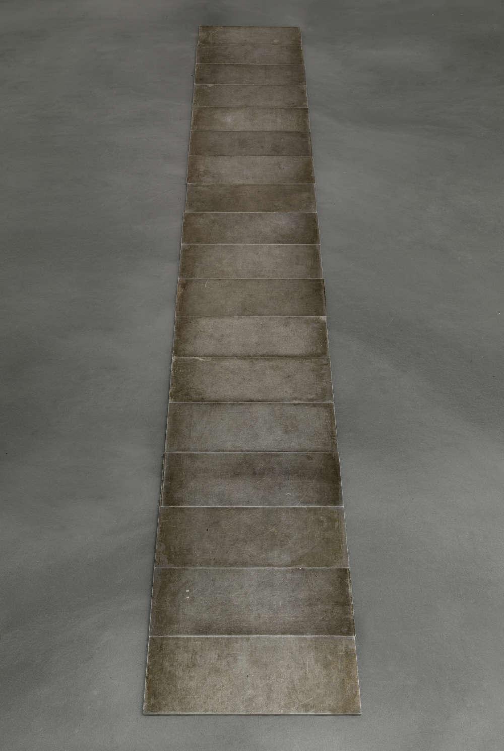 Carl Andre, 18 Aluminum Row, 1968. Aluminium in 18 units Each: 1.2 x 39 x 13.9 cm (1/2 x 15 3/8 x 5 1/2 in.) Overall: 1.2 x 39 x 251.4 cm (1/2 x 15 3/8 x 99 in.) Courtesy the artist and Simon Lee Gallery, London