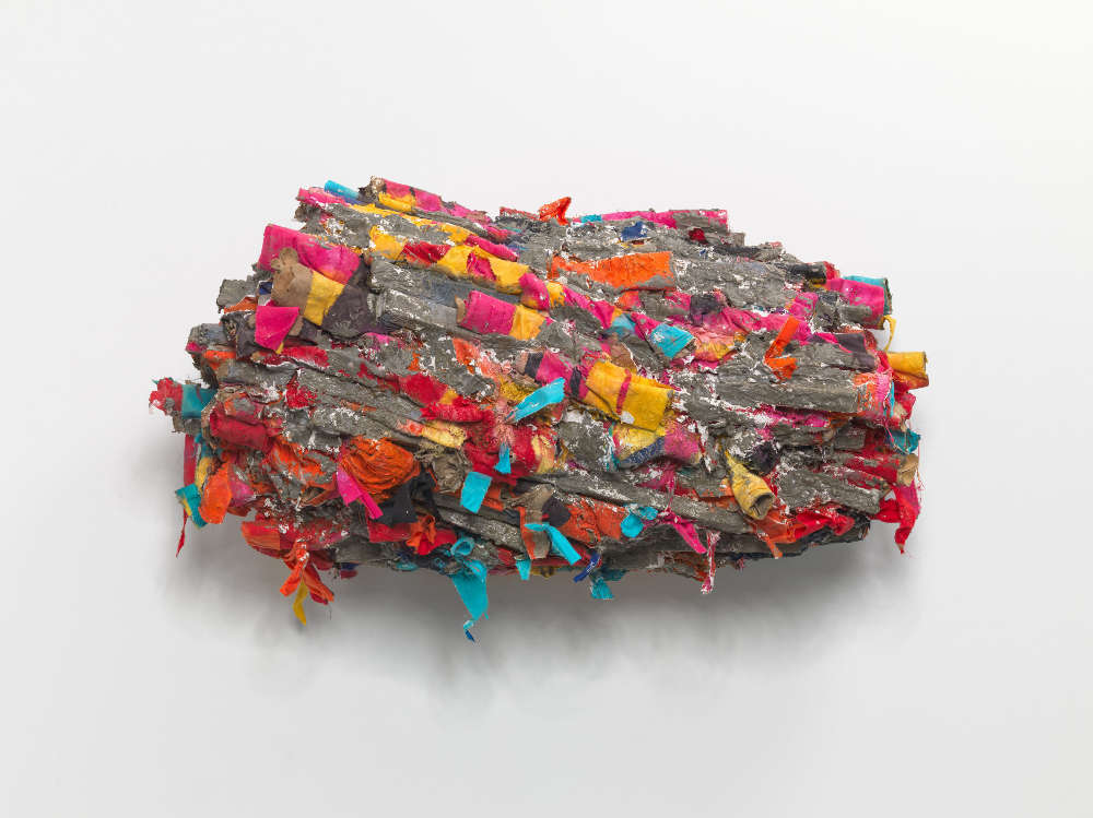 Phyllida Barlow, untitled: pressed; 2018. Cardboard, cement, PVA, paint, plaster, plywood, polycotton, polyurethane foam, sand, spray paint, tape, timber, steel 69 x 120 x 58 cm / 27 1/8 x 47 1/4 x 22 7/8 in © Phyllida Barlow. Courtesy the artist and Hauser & Wirth. Photo: Alex Delfanne