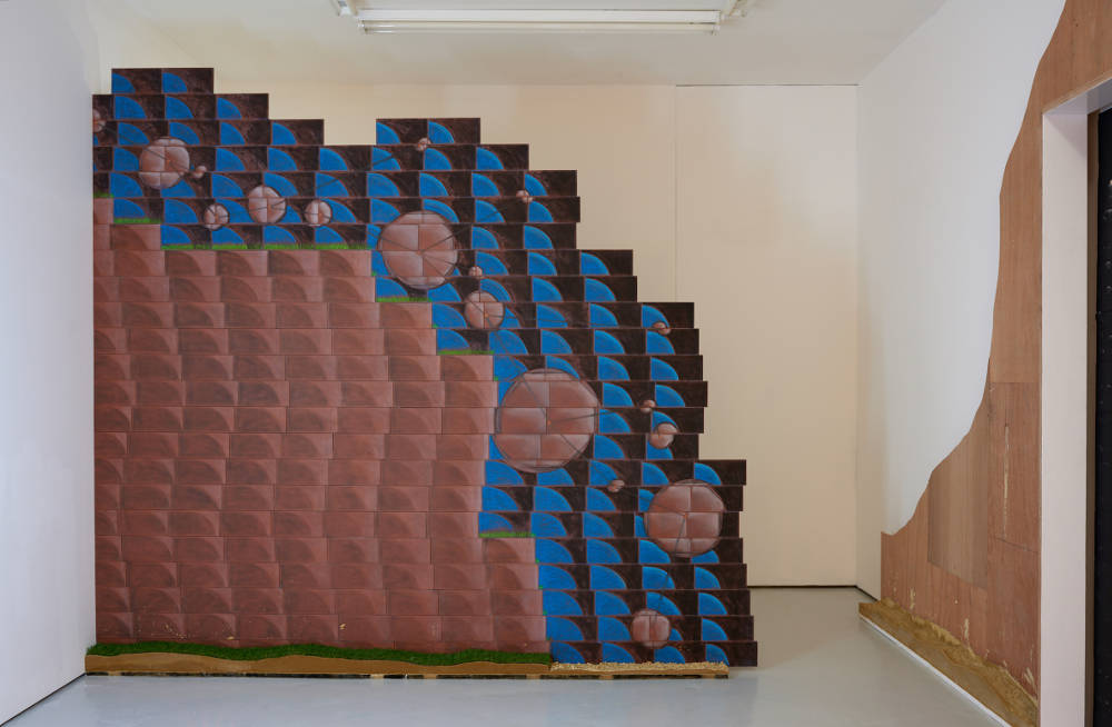 Josephine Baker, Landslide, 2019. Chalk and charcoal on terracotta tiles, plywood, artificial grass, mortar, timber, painted MDF W244 x L30 x H234cm