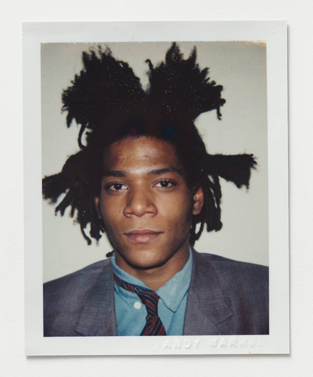Andy Warhol, Jean-Michel Basquiat, 1982. Polacolor ER 10.8 x 8.5 cm / 4.3 x 3.4 in. [H x W] Embossed recto lower right ©ANDY WARHOL; inscribed verso upper centre in pencil FA05.01692; stamped verso lower left and lower right Authorized by the Andy Warhol Foundation for the Visual Arts, The Estate of Andy Warhol. © 2018 The Andy Warhol Foundation for the Visual Arts, Inc. / Licensed by DACS, London. Courtesy BASTIAN, London