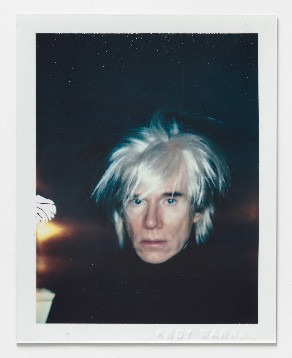 Andy Warhol, Self-Portrait in Fright Wig, 1986. Polacolor ER 10.8 x 8.5 cm / 4.3 x 3.4 in. [H x W] Embossed recto lower right ©ANDY WARHOL; inscribed verso upper left in pencil FA02.00197; stamped verso lower left and lower right Authorized by the Andy Warhol Foundation for the Visual Arts, The Estate of Andy Warhol. © 2018 The Andy Warhol Foundation for the Visual Arts, Inc. / Licensed by DACS, London. Courtesy BASTIAN, London