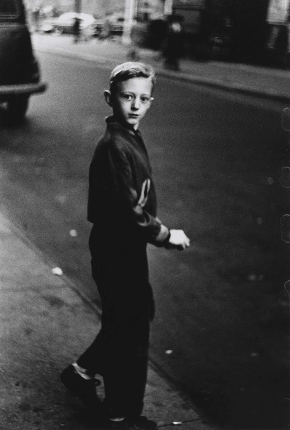 Boy stepping off the curb, N.Y.C. 1957–58. Image: 10 in. × 6 7/8 in. (25.4 × 17.4 cm) Collection of Jeffrey Fraenkel and Alan Mark. Courtesy The Metropolitan Museum of Art, New York. Copyright © The Estate of Diane Arbus, LLC. All Rights Reserved