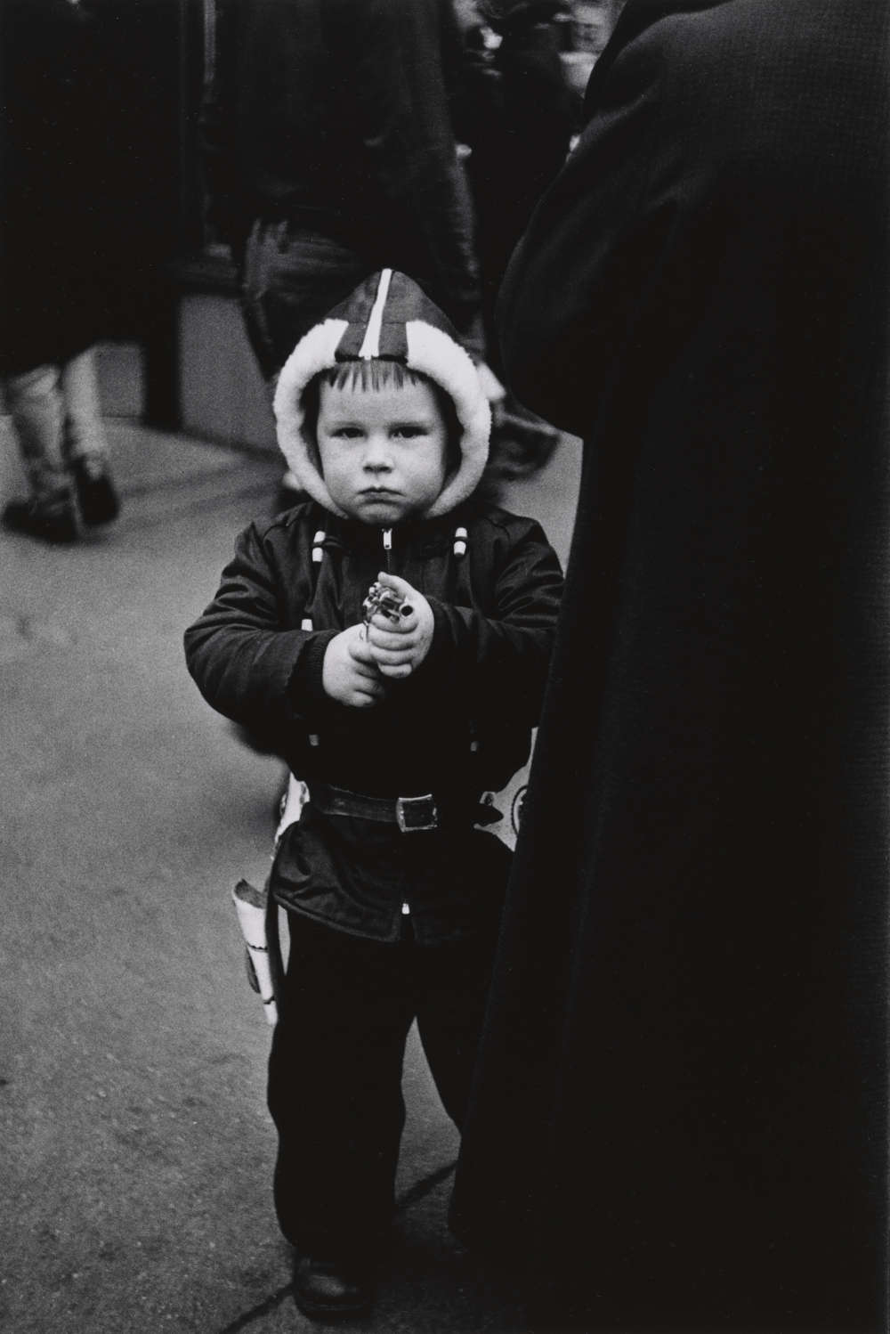 Kid in a hooded jacket aiming a gun, N.Y.C. 1957. 8 1/2 × 5 13/16 in. (21.6 × 14.7 cm) Gift of Doon Arbus and Amy Arbus, 2007. Courtesy The Metropolitan Museum of Art, New York. Copyright © The Estate of Diane Arbus, LLC. All Rights Reserved