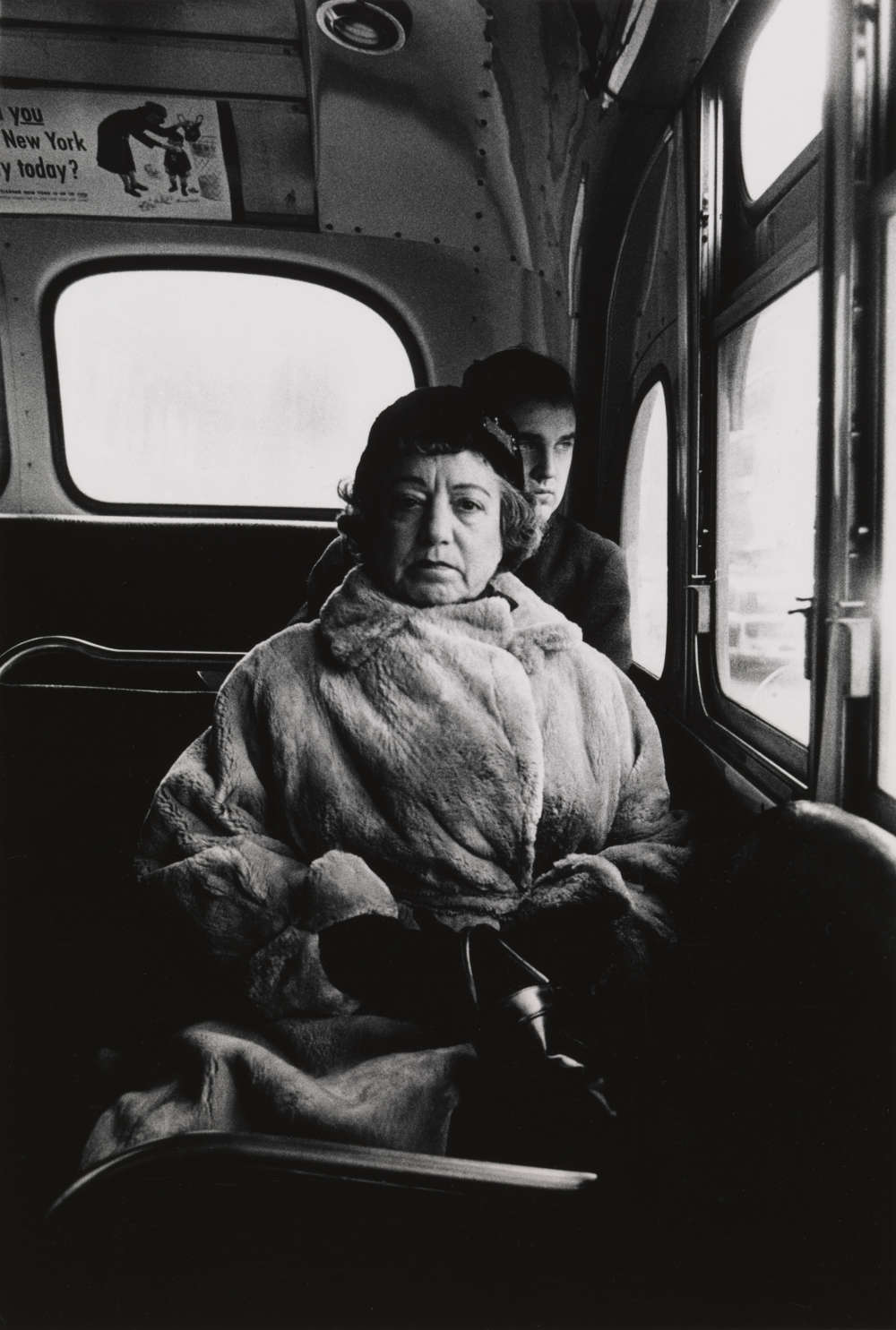 Lady on a bus, N.Y.C. 1957. 8 1/2 × 5 3/4 in. (21.6 × 14.6 cm) Gift of Danielle and David Ganek, 2005. Courtesy The Metropolitan Museum of Art, New York. Copyright © The Estate of Diane Arbus, LLC. All Rights Reserved