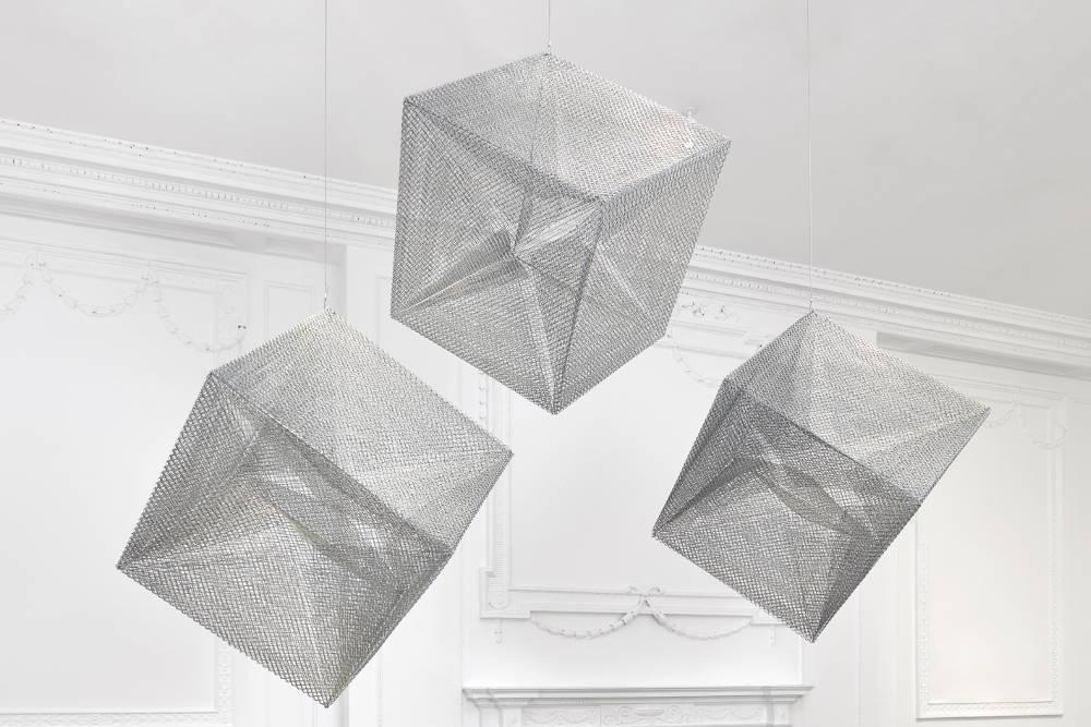 Lydia Okumura, Cube 1,2,3. First realized at the Museu de Arte Moderna, São Paulo, 1984. Stainless steel wire mesh. Each: 30 × 30 × 30 inches (76.20 × 76.20 × 76.20 cm) Edition 2/4 + II AP. Courtesy of Galerie Thaddeus Ropac, London, Paris, Salzburg. © Lydia Okumura