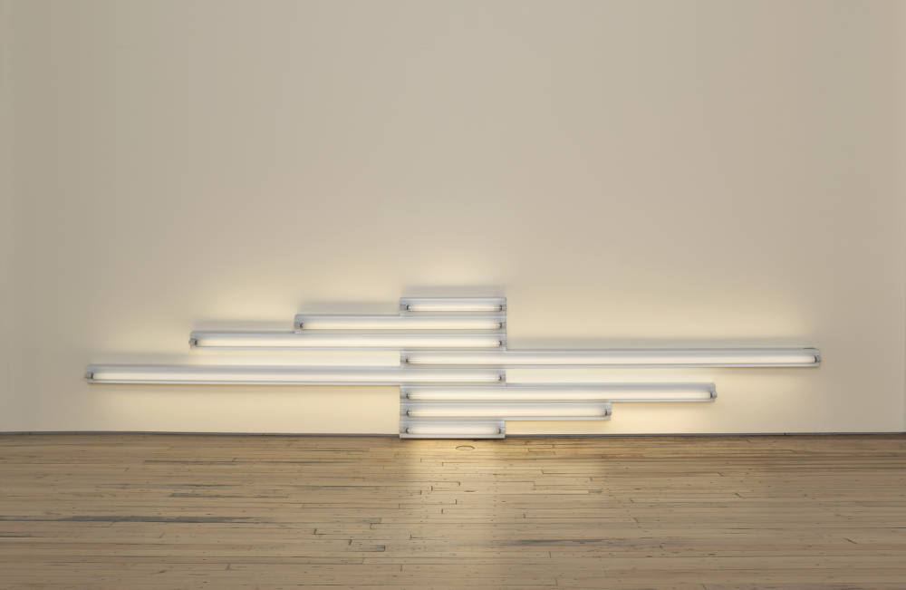 Dan Flavin, Monument for V. Tatlin, 1968. Cool white fluorescent light, width 427 cm width 168 1/8 in. Edition 1 of 5 © 2018 Estate of Dan Flavin / Artists Rights Society (ARS), New York. Courtesy David Zwirner & Cardi Gallery
