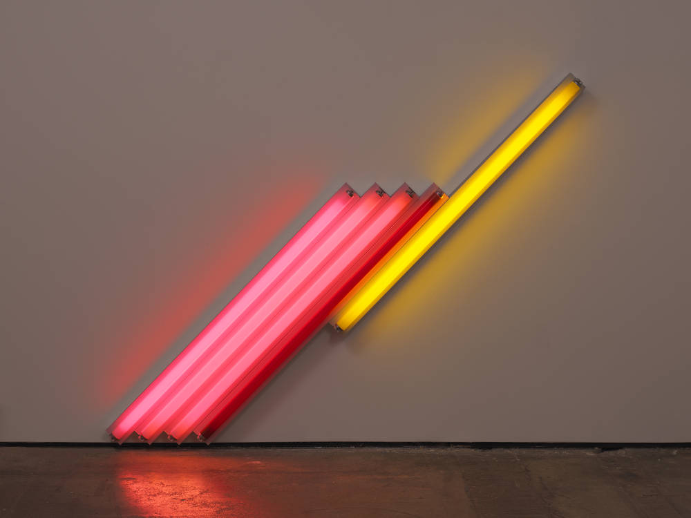 Dan Flavin, Untitled (for Frederika and Ian) 2, 1987. Pink, red, and yellow fluorescent light, 183 cm cm long on the diagonal, 72 1/8 in long on the diagonal. Edition 2 of 5 © 2018 Estate of Dan Flavin / Artists Rights Society (ARS), New York. Courtesy David Zwirner & Cardi Gallery