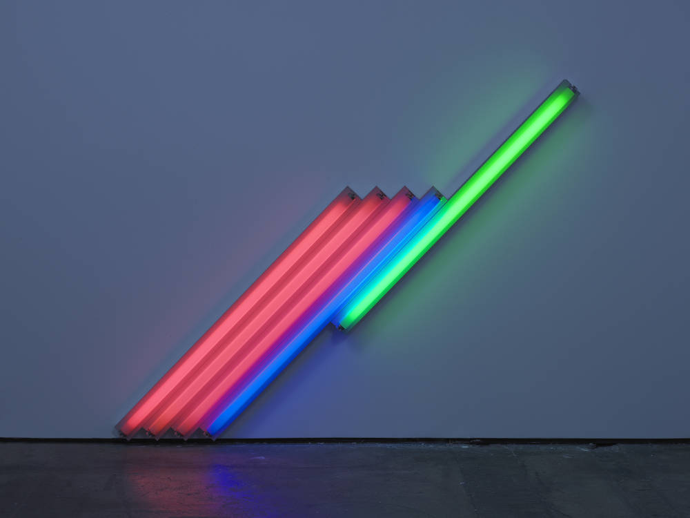 Dan Flavin, Untitled (for Frederika and Ian) 4, 1987. Pink, blue, and green fluorescent light, 183 cm cm long on the diagonal, 72 1/8 in long on the diagonal. Edition 4 of 5 © 2018 Estate of Dan Flavin / Artists Rights Society (ARS), New York. Courtesy David Zwirner & Cardi Gallery