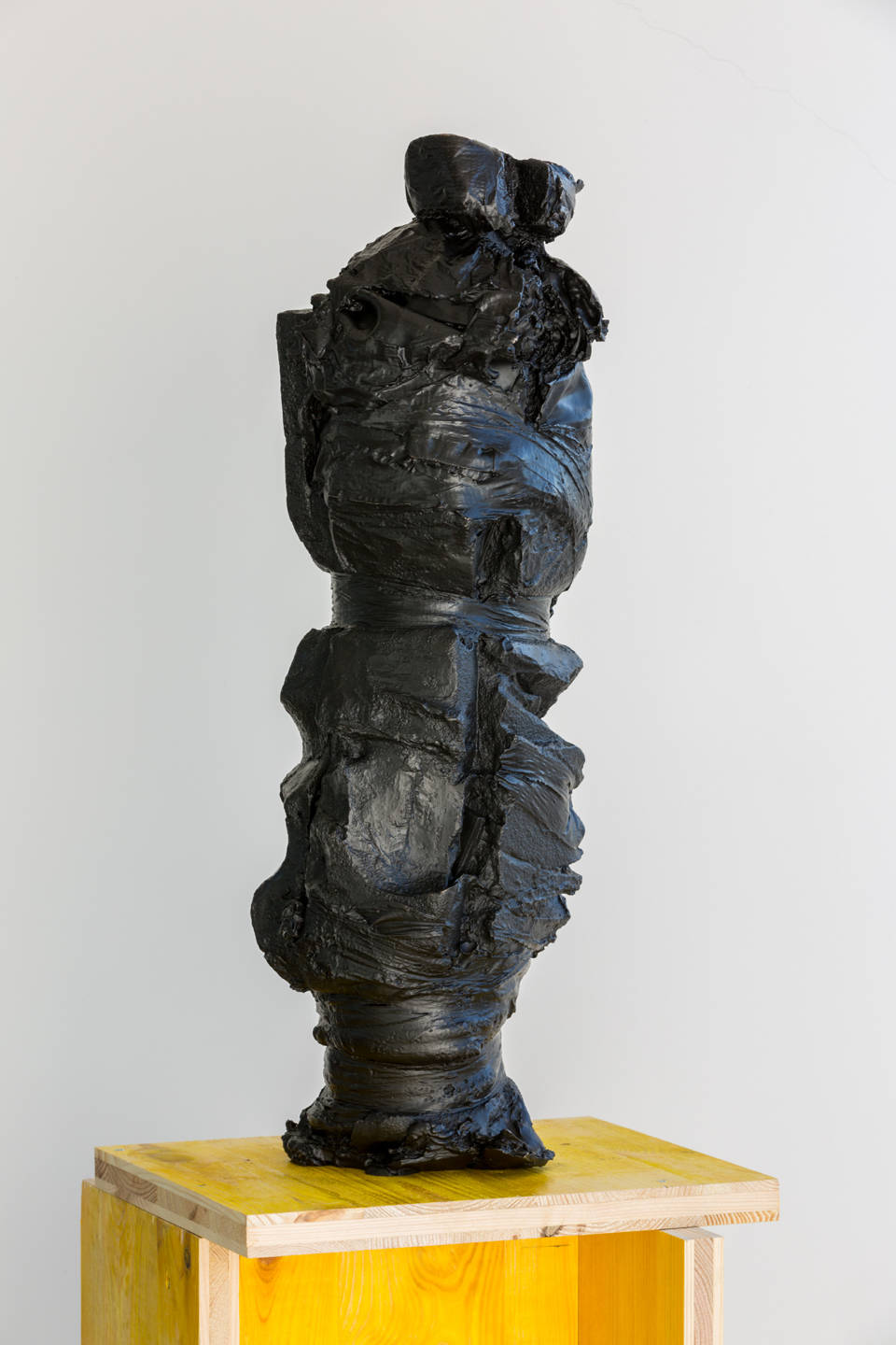 Pedro Cabrita Reis, Strapped, 2019. Bronze and formwork (doka) pedestal, sculpture 70 x 22 x 20 cm (27 1/2 x 8 5/8 x 7 7/8 in.) total 176 x 38 x 36 cm (69 1/4 x 15 x 14 1/8 in.)