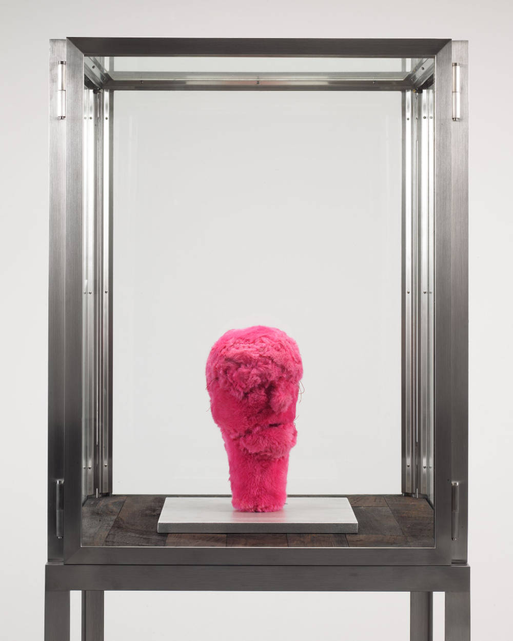 Louise Bourgeois, Untitled, 2001. Pink fabric and aluminum 31.1 x 29.8 x 29.8 cm / 12 1/4 x 11 3/4 x 11 3/4 in. Stainless steel, glass and wood vitrine: 188 x 60.9 x 60.9 cm / 70 x 24 x 24 in. Photo: Christopher Burke © The Easton Foundation/VAGA at ARS, NY. Courtesy The Easton Foundation and Hauser & Wirth