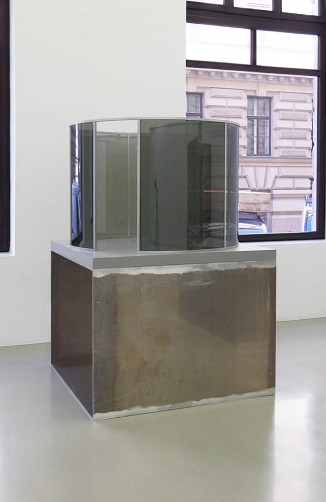 Dan Graham, Little Perforated Cylinder inside Big Two-Way Mirror Cylinder, 2019. Two-way mirror glass, aluminum, wood, acrylic, corian 92 (h) x 125 x 125 cm
