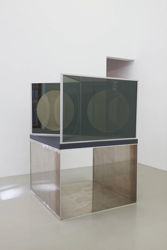 Dan Graham, Moongate Pavilion, 2019. Two-way mirror glass, aluminum, wood, acrylic, corian, 92 (h) x 125 x 125 cm