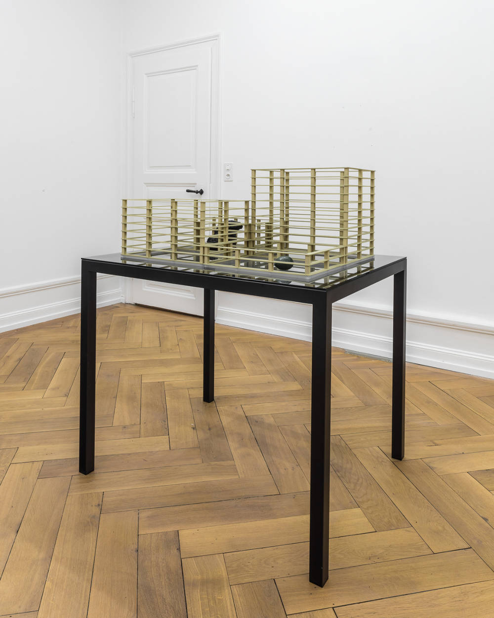 Jorge Méndez Blake, Project for an Empty Library (For James Joyce) , 2019. Brass, bronze, smoked mirror, iron, 2 parts, total 115.5 x 98 x 98 cm (45 1/2 x 38 5/8 x 38 5/8 in.)