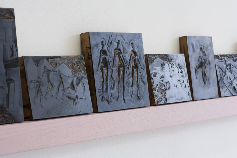 The Blocks - Joan Ellis (detail), 1924 – 28. 25 wood-engraving blocks, boxwood and printing ink, (dimensions variable) on painted shelf – length 356cm. Photo: Cameron Leadbetter
