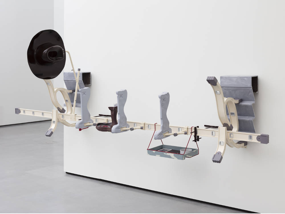 Magali Reus, Dearest (Achilles), 2018. Milled and powder coated aluminum and steel, hex nuts and bolts, fiberglass and polyester resin, pigments, milled and sprayed model board, C-type print, acrylic, engraved aluminum, laser cut and rusted steel 131 x 360 x 108 cm / 51 5/8 x 141 3/4 x 42 1/2 in © Magali Reus. Courtesy the artist and Galerie Eva Presenhuber, Zurich / New York. Photo: Lewis Ronald