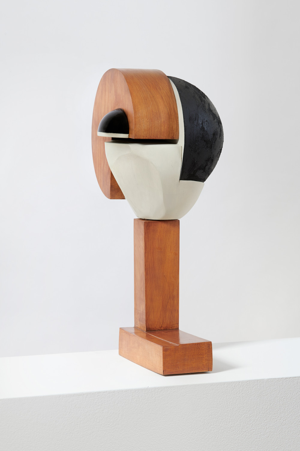 Christina Kruse, Round, 2018. Wood, acrylic paint, charcoal, lacquer, and wax 18 x 12 x 8 inches