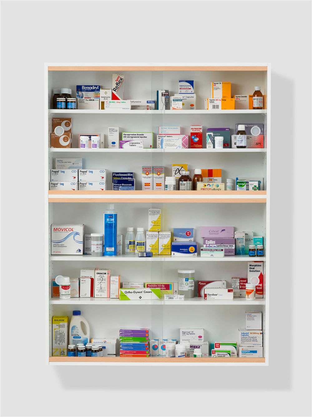 Damien Hirst, Satellite, 1989-2010. Glass, faced particleboard, ramin, plastic, aluminium and pharmaceutical packaging 137 × 102 × 23 cm 54 × 40 × 9 in. Photographed by Prudence Cuming Associates © Damien Hirst and Science Ltd. All rights reserved, DACS 2019