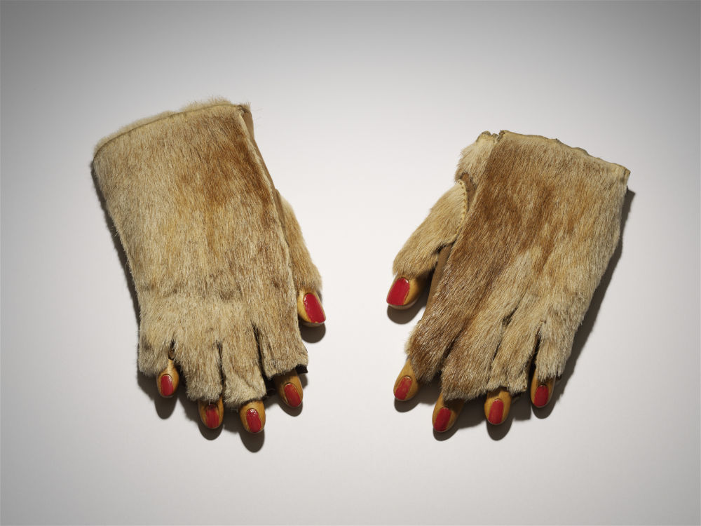 Meret Oppenheim, Fur Gloves With Wooden Fingers, 1936. Fur gloves, wooden fingers, nail polish 5 x 21 x 10 cm / 2 x 8 1/4 x 3 7/8 in © DACS 2019. Courtesy of the Ursula Hauser Collection, Switzerland. Photo credit: Stefan Altenburger Photography Zürich
