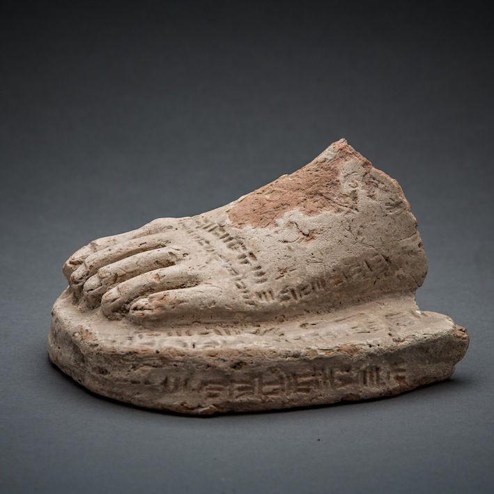 Foot With Inscription, c.2100 - 1600 BCE, 9 x 13 x 13 cm Mesopotamia