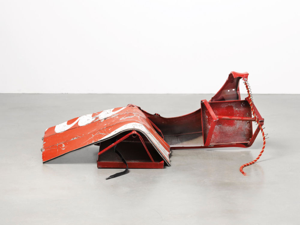 Robert Rauschenberg, Red Crawler Glut, 1987. Assembled metal, with fabric cord and strap 62.2 x 154.9 x 58.4 cm (24.5 x 61 x 23 in) Galerie Thaddaeus Ropac © Robert Rauschenberg Foundation/VAGA at ARS, NY and DACS, London 2019. Photo: Ulrich Ghezzi