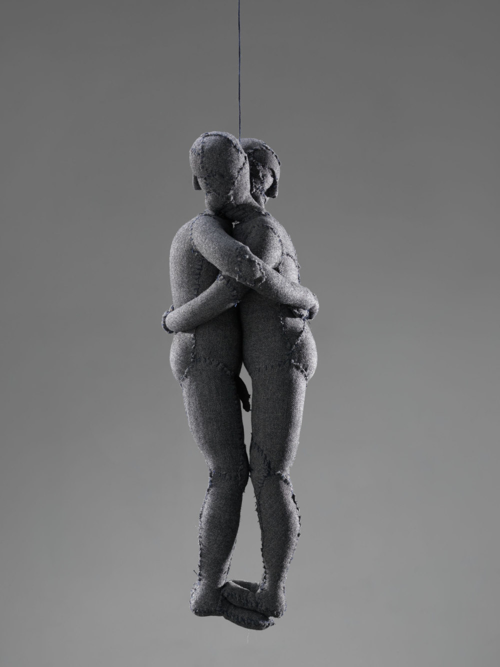 Louise Bourgeois, Couple, 2002. Fabric, hanging piece 43.2 x 17.8 x 12.7 cm / 17 x 7 x 5 in. Stainless steel, glass and wood vitrine: 193 x 60.9 x 60.9 cm / 76 x 24 x 24 in © The Easton Foundation / 2019, ProLitteris, Zurich. Courtesy the Foundation and Hauser & Wirth. Photo: Christopher Burke