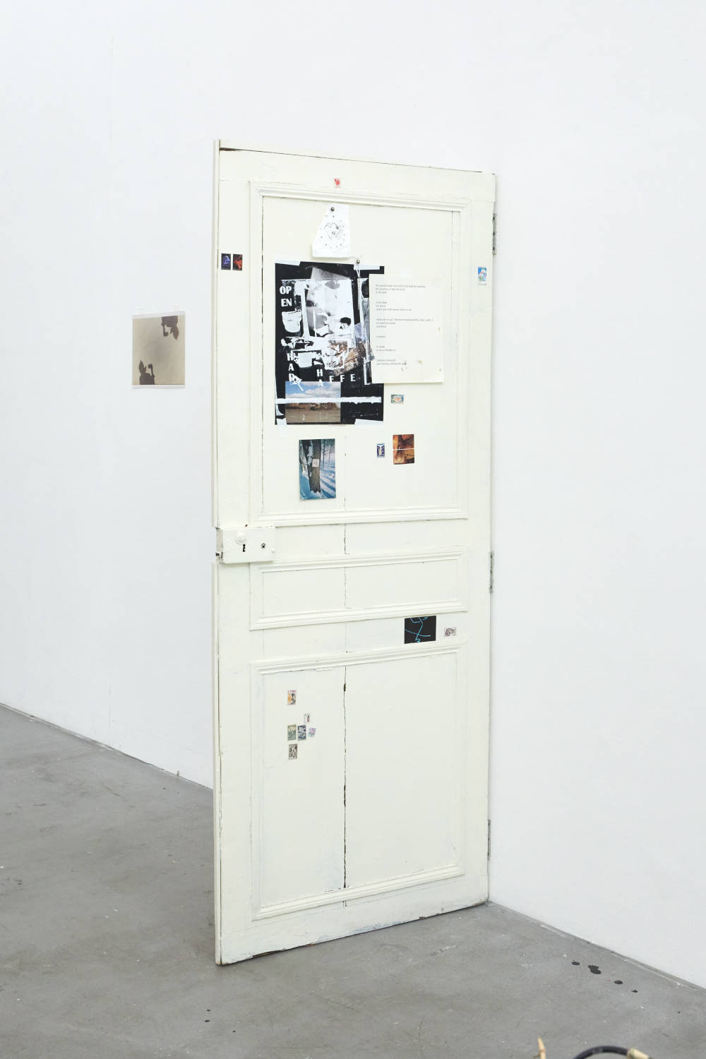 Ryan Foerster & Hannah Buonaguro, here I opened wide the door, 2019. Wood door, paint, c prints, inkjet prints, stamps, glass, plastic, metal, keys, toilet paper, stickers. Variable dimensions. Courtesy of the artist & VNH Gallery. Photo: Johanna Benaïnous