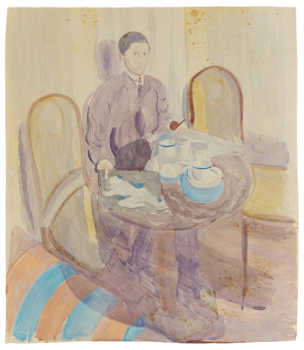 Man at table, holding a pipe and drawing